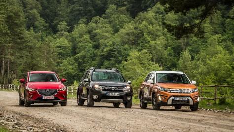Dacia Duster versus Mazda CX-3, Suzuki Vitara. Între două lumi