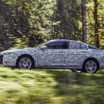 New presence: The elegant and athletic silhouette of Opel's future flagship, the Insignia Grand Sport, is clearly visible despite the camouflage.